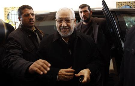 Rached Ghannouchi (C), leader of the Ennahda Party, arrives at a meeting in Tunis December 23, 2013. REUTERS/Zoubeir Souissi
