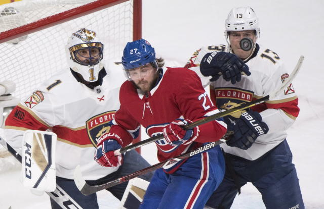 Montreal Canadiens left wing Alex Galchenyuk (27) moves in on Florida Panthers goaltender Roberto Luongo (1) as Panthers defenseman Mark Pysyk (13) defends during first period NHL hockey action in Montreal, Monday, March 19, 2018. (Graham Hughes/The Canadian Press via AP)