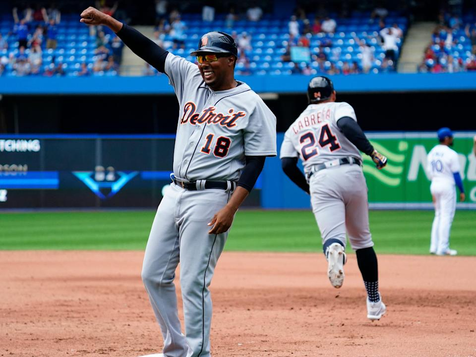 Detroit Tigers first base coach Kimera Bartee celebrates Miguel Cabrera's tying solo home run against the Toronto Blue Jays in the sixth inning at Rogers Centre. The home run was the 500th of his career on August 22, 2021.