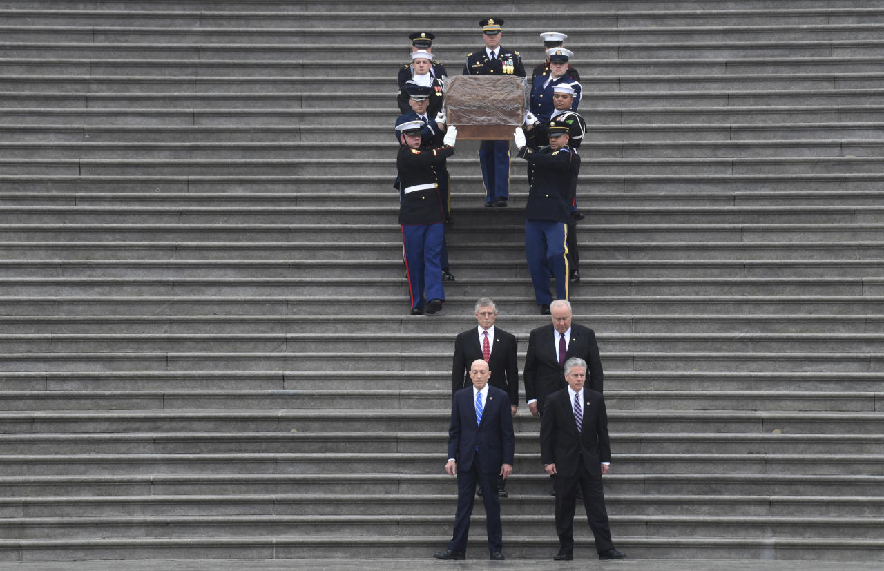 <p>The casket of Rev. Billy Graham is carried down the steps of the U.S. Capitol in Washington, Thursday, March 1, 2018. (Photo: Susan Walsh/AP) </p>