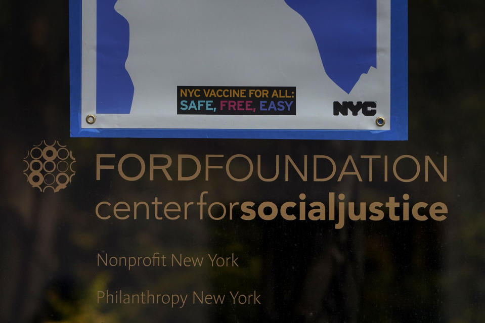 A sign is displayed on a window of the Ford Foundation Building in New York, Friday, Feb. 19, 2021. The foundation is one of nine grant makers that have issued a total of $3 billion in debt since June to cover increases in their grant making. (AP Photo/Seth Wenig)