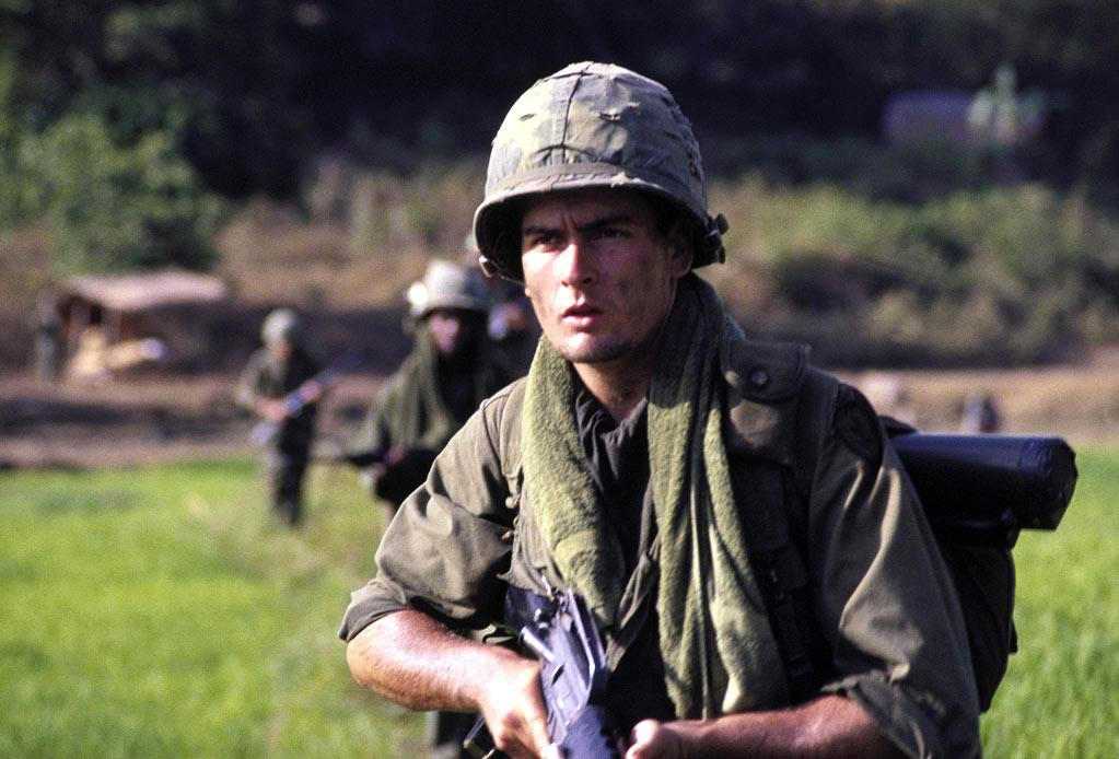 "<a href=""http://movies.yahoo.com/movie/1800106663/info"">Platoon</a> (1986): Sheen is at the center of Oliver Stone's Vietnam War epic -- he's standing in for Stone, really -- as a young man conflicted about war and his place in the world, while simultaneously being torn between two powerful superiors. The film is immediate, intense and visceral, the winner of four Academy Awards including best picture and best director. It's a spectacle of chaos, but Sheen -- whose character, Chris, has dropped out of college to volunteer for the war because he feels it's his patriotic duty -- infuses it with introspection and humanity. This, and the next film on the list, would make Sheen a superstar in the mid-1980s."