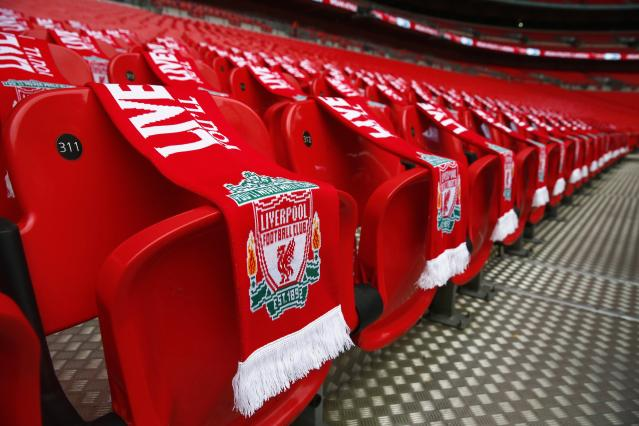 Ninety-six Liverpool scarves are placed on seats on the 25th anniversary of the Hillsborough disaster before the FA Cup semi-final soccer match between Arsenal and Wigan Athletic at Wembley Stadium in London April 12, 2014. Every senior match in England will kick-off seven minutes later than normal this weekend as soccer marks the 25th anniversary of the Hillsborough disaster, when 96 Liverpool fans died at an FA Cup semi-final against Nottingham Forest. REUTERS/Eddie Keogh (BRITAIN - Tags: ANNIVERSARY DISASTER SPORT SOCCER)