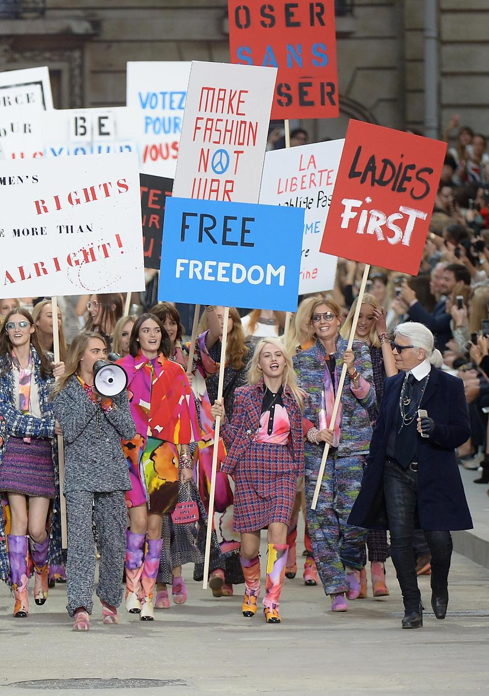 <p>Karl Lagerfeld joins in on the catwalk protests at his SS15 show in Paris. <em>[Photo: Getty]</em> </p>