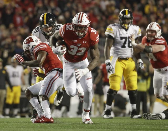 Wisconsin's Leon Jacobs runs back a fumble for a touchdown during the second half of an NCAA college football game against Iowa Saturday, Nov. 11, 2017, in Madison, Wis. (AP Photo/Morry Gash)