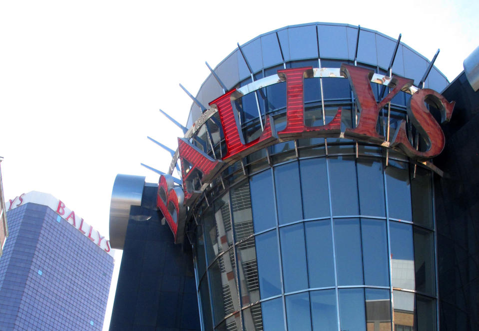 This Oct. 1, 2020 photo shows the exterior of Bally's casino in Atlantic City, N.J. The new owners of Bally's Atlantic City are attempting to revive a comatose casino in perhaps the most cutthroat gambling market in America. Rhode Island-based Bally's Corporation is spending at least $90 million on the Boardwalk casino over the next five years, including hotel room makeovers, a renovation of the casino floor, new slot machines and restaurants, and more live entertainment. (AP Photo/Wayne Parry)