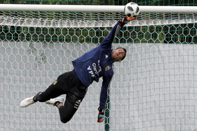 Goalkeeper Nahuel Guzman stops a shot during a training session of Argentina at the 2018 soccer World Cup in Bronnitsy, Russia, Wednesday, June 13, 2018. (AP Photo/Ricardo Mazalan)