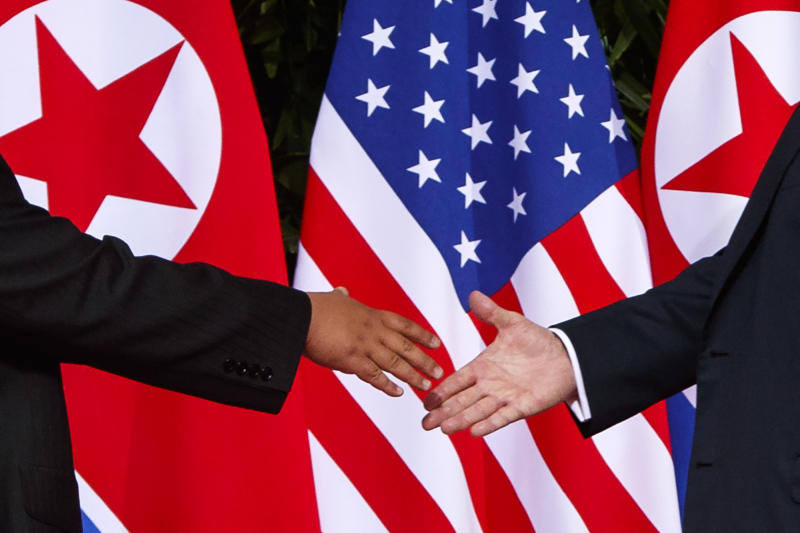 FILE - In this Tuesday, June 12, 2018, file photo, U.S. President Donald Trump, right, reaches to shake hands with North Korea leader Kim Jong Un at the Capella resort on Sentosa Island in Singapore. The North's Korean Central News Agency said Thursday, Jan. 24, 2019 that Kim received a letter from Trump from a North Korean envoy who travelled to Washington and met Trump last week. North Korea says Kim has ordered preparations for a second summit with Trump. (AP Photo/Evan Vucci, File)