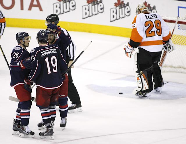 Columbus Blue Jackets' Ryan Johansen (19) is congratulated by teammates after scoring on Philadelphia Flyers goalie Ray Emery (29) during the third period of an NHL hockey game on Saturday, Dec. 21, 2013, in Columbus, Ohio. Columbus won 6-3. (AP Photo/Mike Munden)