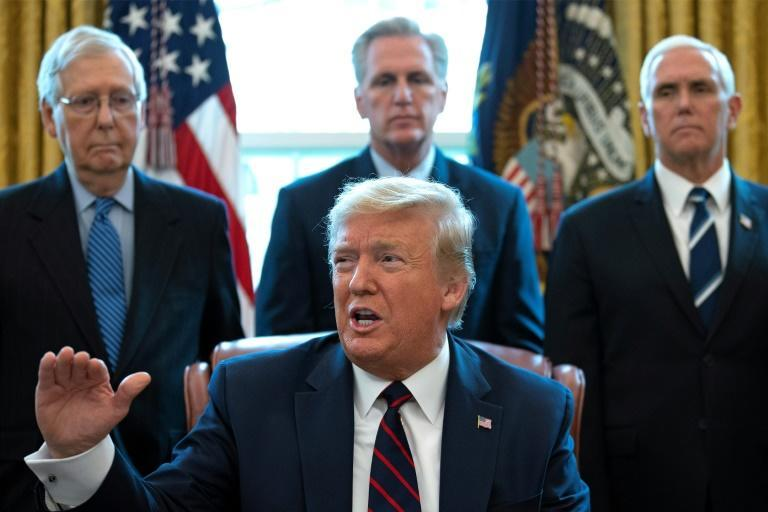 US President Donald Trump signed a $2 trillion rescue package into law to provide economic relief amid the coronavirus outbreak (AFP Photo/JIM WATSON)