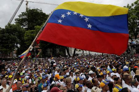 Supporters of Venezuelan opposition leader Juan Guaido, who many nations have recognised as the country's rightful interim ruler, take part in a rally in support of the Venezuelan National Assembly and against the government of Venezuela's President Nicolas Maduro in Caracas, Venezuela, May 11, 2019. REUTERS/Ueslei Marcelino