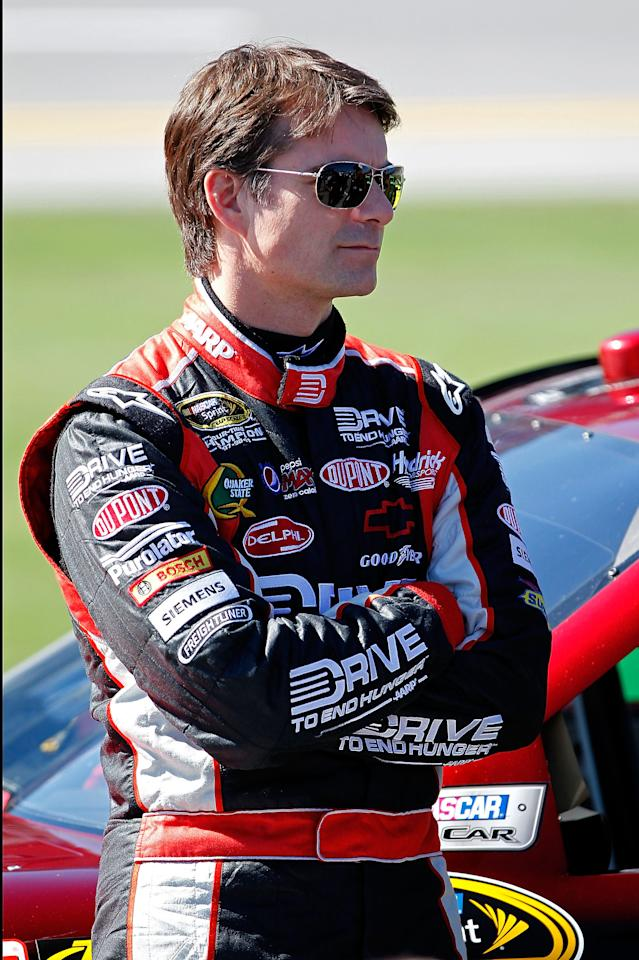 TALLADEGA, AL - OCTOBER 22:  Jeff Gordon, driver of the #24 Drive to End Hunger Chevrolet, looks on during qualifying for the NASCAR Sprint Cup Series Good Sam Club 500 at Talladega Superspeedway on October 22, 2011 in Talladega, Alabama.  (Photo by Geoff Burke/Getty Images for NASCAR)