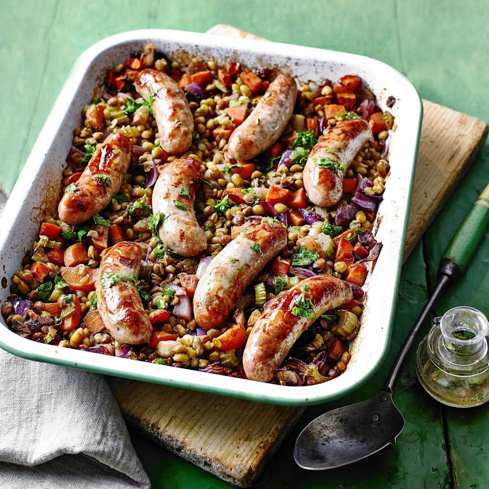 """<p>Tinned lentils are economical and nutritious. Drizzling a vinaigrette over warm food helps it to be absorbed.<br></p><p><strong>Recipe: <a href=""""https://www.goodhousekeeping.com/uk/food/recipes/a29317115/lentil-sausage-traybake/"""" rel=""""nofollow noopener"""" target=""""_blank"""" data-ylk=""""slk:Green Lentil and Sausage Traybake"""" class=""""link rapid-noclick-resp"""">Green Lentil and Sausage Traybake</a></strong></p>"""