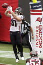 Atlanta Falcons tight end Hayden Hurst (81) catches a touchdown pass against the Tampa Bay Buccaneers during the second half of an NFL football game Sunday, Jan. 3, 2021, in Tampa, Fla. (AP Photo/Mark LoMoglio)