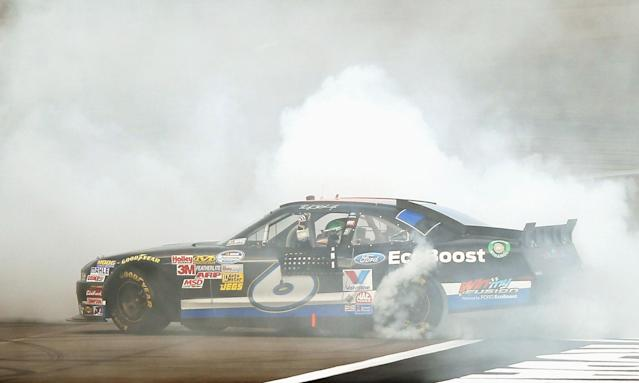 LAS VEGAS, NV - MARCH 10: Ricky Stenhouse Jr., driver of the #6 Ford EcoBoost Ford, does a burnout after winning the NASCAR Nationwide Series Sam's Town 300 at Las Vegas Motor Speedway on March 10, 2012 in Las Vegas, Nevada. (Photo by Ezra Shaw/Getty Images)