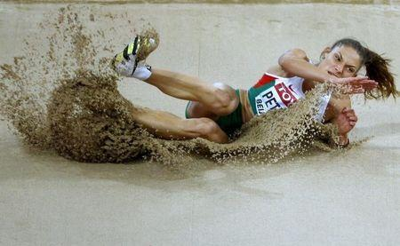 Gabriela Petrova of Bulgaria competes in the women's triple jump qualification during the 15th IAAF World Championships at the National Stadium in Beijing, China August 22, 2015. REUTERS/Damir Sagolj