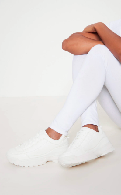 "<br><br><strong>Pretty Little Thing</strong> Chunky Cleated Sole Sneakers, $, available at <a href=""https://go.skimresources.com/?id=30283X879131&url=https%3A%2F%2Fwww.prettylittlething.us%2Fwhite-chunky-cleated-sole-sneakers.html"" rel=""nofollow noopener"" target=""_blank"" data-ylk=""slk:Pretty Little Thing"" class=""link rapid-noclick-resp"">Pretty Little Thing</a>"
