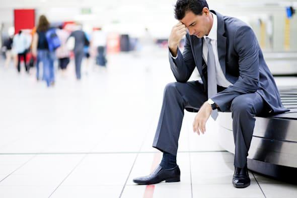 worried businessman lost his luggage at airport