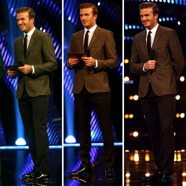 <b>David Beckham </b><br><br>The footballer looked dapper in a tweed suit and brogue shoes as he presented an award on stage.<br><br>© PA