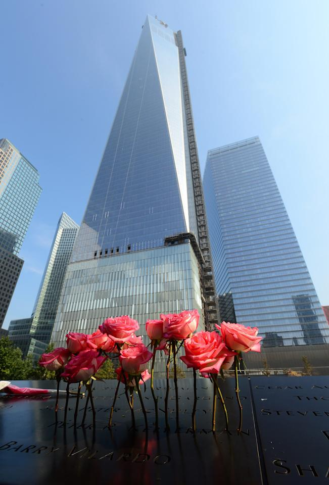 Roses stand in an etched name at the 9/11 Memorial during a ceremony marking the 12th Anniversary of the attacks on the World Trade Center in New York September 11, 2013. REUTERS/David Handschuh/Pool (UNITED STATES - Tags: DISASTER ANNIVERSARY)