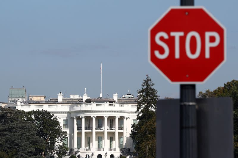 FILE PHOTO: A 'Stop' sign is seen in front of the White House in Washington