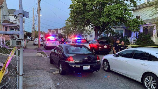 PHOTO: Police respond to the scene where at least nine people were wounded in a shooting outside a home in Providence, Rhode Island, on May 13, 2021. (William J. Kole/AP)