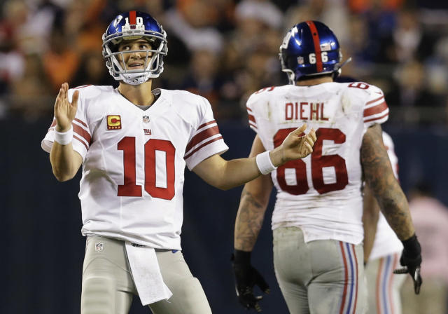 New York Giants quarterback Eli Manning (10) reacts after throwing an incomplete pass in the first half of an NFL football game against the Chicago Bears, Thursday, Oct. 10, 2013, in Chicago. (AP Photo/Nam Y. Huh)