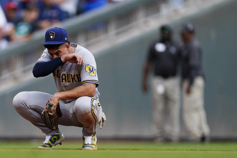 Milwaukee Brewers shortstop Willy Adames (27) waits for play to resume during the eighth inning of Game 3 of a baseball National League Division Series between the Atlanta Braves and the Milwaukee Brewers, Monday, Oct. 11, 2021, in Atlanta. (AP Photo/John Bazemore)