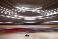 <p>IZU, JAPAN - AUGUST 04: Patryk Rajkowski of Poland warms up on the track on day twelve of the Tokyo 2020 Olympic Games at Izu Velodrome on August 04, 2021 in Izu, Japan. (Photo by Justin Setterfield/Getty Images)</p>