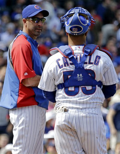 Chicago Cubs manager Dale Sveum, left, talks with catcher Welington Castillo as they wait for relief pitcher Hector Rondon during the eighth inning of a baseball game against the Cincinnati Reds in Chicago, Saturday, May 4, 2013. The Reds won 6-4. (AP Photo/Nam Y. Huh)