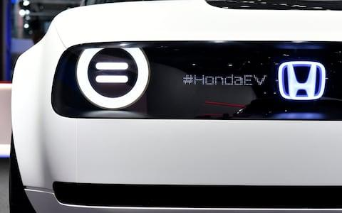 The Honda concept allows the driver to send brief messages using screens on the front and back - Credit: SASCHA STEINBACH /EPA