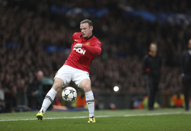 Manchester United's Wayne Rooney controls a ball during the Champions League quarterfinal first leg soccer match between Manchester United and Bayern Munich at Old Trafford Stadium, Manchester, England, Tuesday, April 1, 2014.(AP Photo/Jon Super)