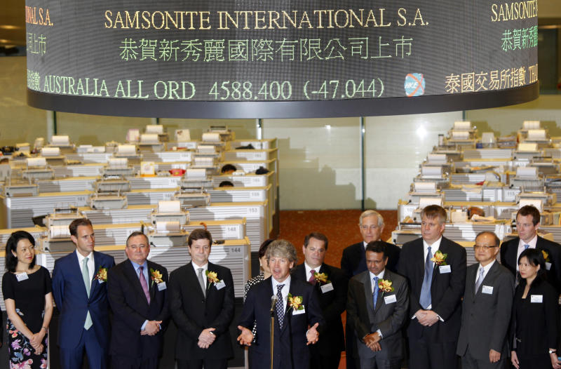 Chairman of Samsonite International S.A. Tim Parker, center, speaks  during the trading debut of Samsonite International in Hong Kong Thursday, June 16, 2011. Shares of the luggage maker plunged on their first day of trading, amid waning investor interest in IPOs as global stock markets slide. (AP Photo/Vincent Yu)