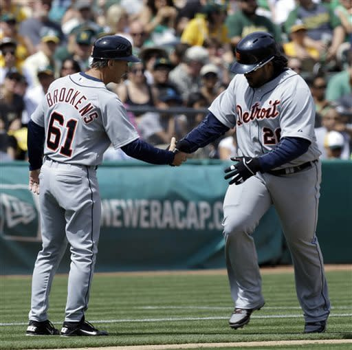 Detroit Tigers' Prince Fielder, right, is congratulated by third base coach Tom Brookens after Fielder hit a home run off Oakland Athletics' Brett Anderson in the fourth inning of a baseball game Saturday, April 13, 2013, in Oakland, Calif. (AP Photo/Ben Margot)