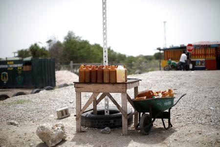 Containers with fuel displayed for sale at a stand on the outskirts of Port-au-Prince, Haiti, July 12, 2018. REUTERS/Andres Martinez Casares