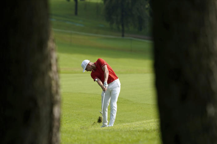 Austria's Sepp Straka plays a shot from the second fairway during the first round of the men's golf event at the 2020 Summer Olympics on Wednesday, July 28, 2021, at the Kasumigaseki Country Club in Kawagoe, Japan. (AP Photo/Matt York)