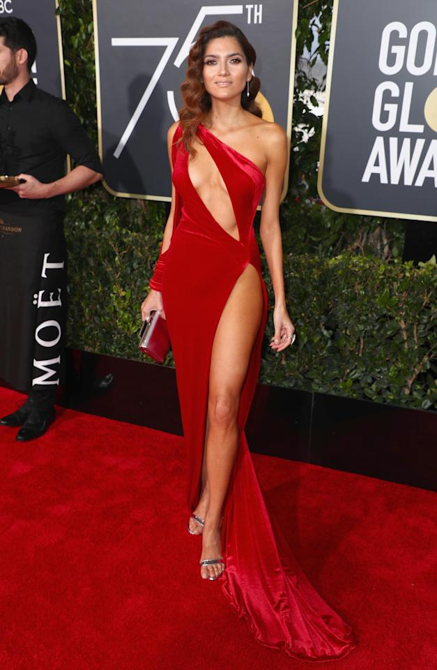 <p>Actress Blanca Blanco decided to buck the black dress trend by showing up in this daring red number which was slashed up to the thigh.</p>