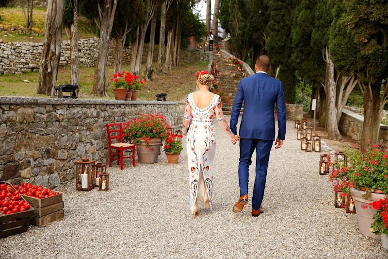 Caroline and David lead the way up the steps to dinner.
