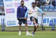 India's captain Virat Kohli, left, and Rishabh Pant warm up ahead of the play on the third day of third test cricket match between England and India, at Headingley cricket ground in Leeds, England, Friday, Aug. 27, 2021. (AP Photo/Jon Super)