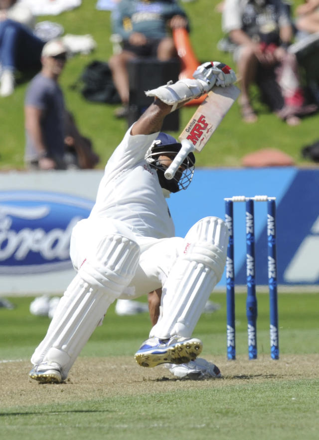 India's Shikar Dhawan stumbles as he attempts to return to his crease against New Zealand on the second day of the second cricket test in Wellington, New Zealand, Saturday, Feb. 15, 2014. (AP Photo/SNPA, Ross Setford) NEW ZEALAND OUT