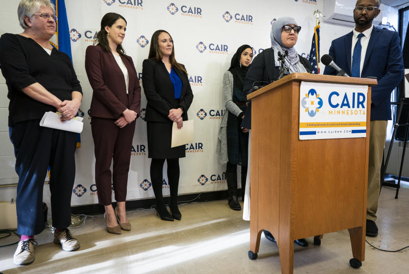 Aida Shyef Al-Kadi, of St. Louis Park, speaks during a press conference at CAIR-MN headquarters in Minneapolis on Tuesday, December 17, 2019. Al-Kadi reached a settlement with Ramsey County for $120,000 after claiming religious discrimination after being forced to remove her hijab for a booking photo and go without a hijab for a time while in jail.  (Leila Navidi/Star Tribune via AP)