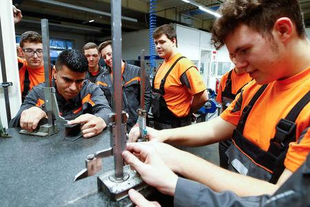 Afghan refugee Hotak takes part in a qualification and integration program for migrants at Ford Motor Co in Cologne