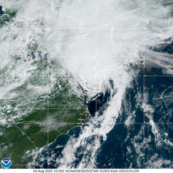 Satellite imagery of Isaias shows it spreading north along the Atlantic coast.
