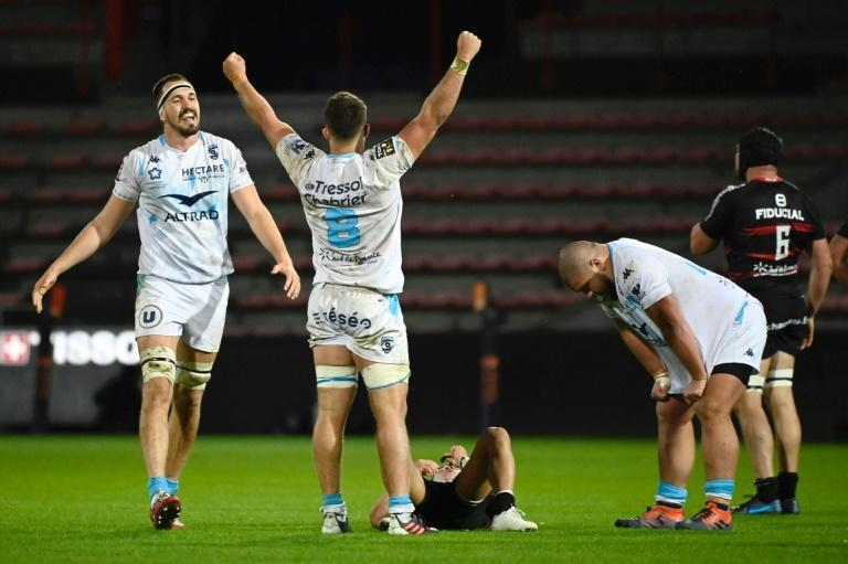 To win in Toulouse: Montpellier try scorer and No. 8 Alex Becognee led celebrations after they upset the Top 14 leaders