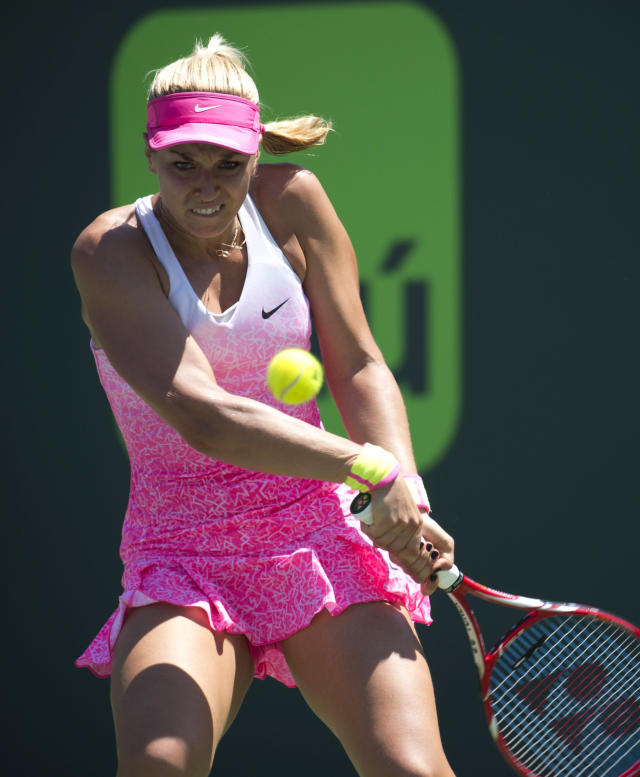 Sabine Lisicki, of Germany, returns the ball to Serena Williams during their match at the Miami Open tennis tournament in Key Biscayne, Fla., Wednesday, April 1, 2015. Williams won 7-6(4), 1-6, 6-3. (AP Photo/J Pat Carter)