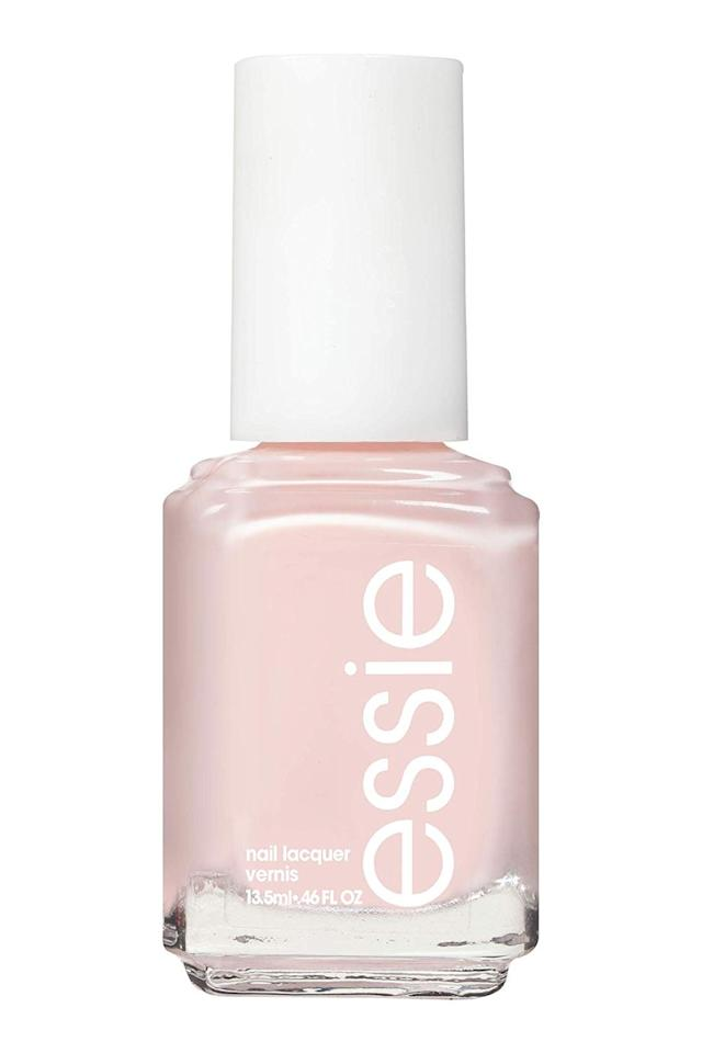 """<p><strong>essie</strong></p><p>amazon.com</p><p><strong>$8.95</strong></p><p><a href=""""http://www.amazon.com/dp/B0030IMVZ6/?tag=syn-yahoo-20&ascsubtag=%5Bartid%7C10049.g.28495772%5Bsrc%7Cyahoo-us"""" target=""""_blank"""">Shop Now</a></p><p>There's a reason this pale-pink <a href=""""https://www.cosmopolitan.com/style-beauty/beauty/g13813011/winter-nail-colors/"""" target=""""_blank"""">nail polish</a> is so loved (like, even <a href=""""https://www.townandcountrymag.com/style/beauty-products/a13121506/kate-middleton-nail-polish/"""" target=""""_blank"""">Kate Middleton</a> is obsessed with it): <strong>It's</strong> j<strong>ust sheer enough that it won't overpower your look</strong>, yet it'll still give you a nice wash of color with two coats.</p>"""