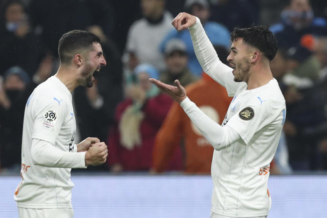 Marseille's Nemanja Radonjic, right, gestures towards Marseille's Alvaro after scoring his side's third goal during the French League One soccer match between Marseille and Bordeaux at the Velodrome stadium in Marseille, southern France, Sunday, Dec. 08, 2019. (AP Photo/Daniel Cole)