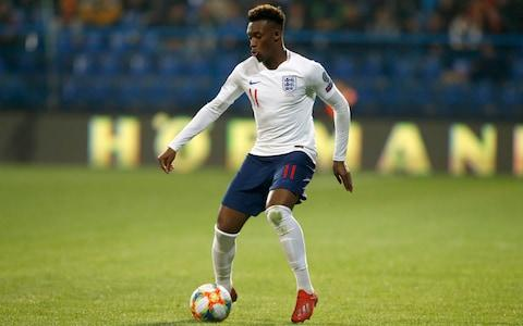 England's Callum Hudson-Odoi dribbles with the ball in his first match for the team during the Euro 2020 group A qualifying soccer match between Montenegro and England - Credit: AP