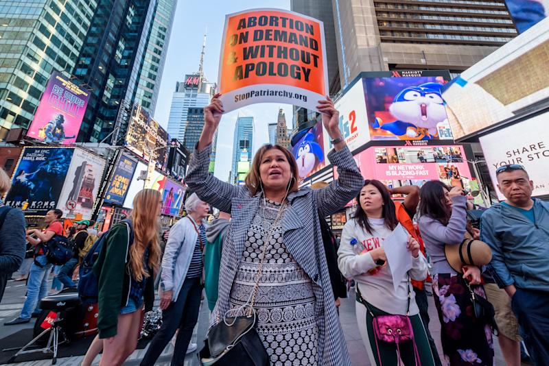 TIMES SQUARE, NEW YORK, UNITED STATES - 2019/06/04: Protesters demanding 'Abortion Without Apology' gathered at at Times Square Red Step as part of a national day of action to stop the abortion bans. Participants wore bloody pants and shouted, Abortion is on the verge of being illegal!. (Photo by Erik McGregor/Pacific Press/LightRocket via Getty Images)