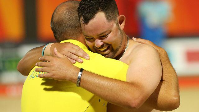 Wilson embraces his coach. Image: Getty